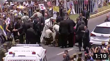 Pope Francis stops popemobile to comfort Chilean policewoman who fell from h